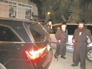 The Biala Rebbe (C) arriving at the site of the meeting.