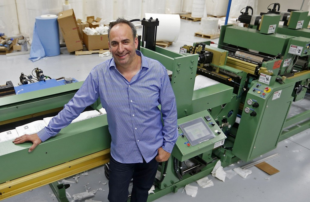 Eric Grossman, CEO of Metropak Inc. in Richardson, Texas, with one of the machines used to make ragbags. (Stewart F. House/Dallas Morning News/MCT)