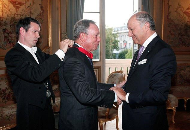 France's foreign minister Laurent Fabius (R) on Sept. 16 awards the Chevalier de la Legion d'Honneur to former Mayor Michael Bloomberg at the Quai d'Orsay in Paris. (AP Photo/Thibault Camus)