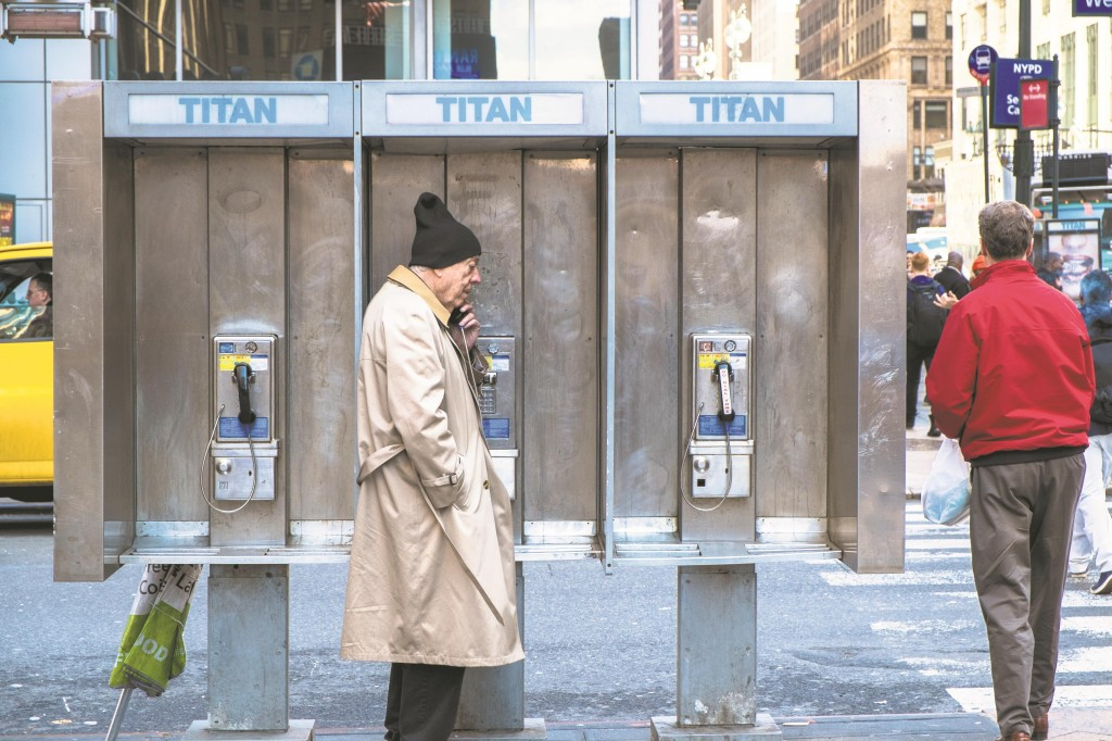 New York City on Monday halted a plan for Titan to outfit phone booths with transmitters that could track people's movements.