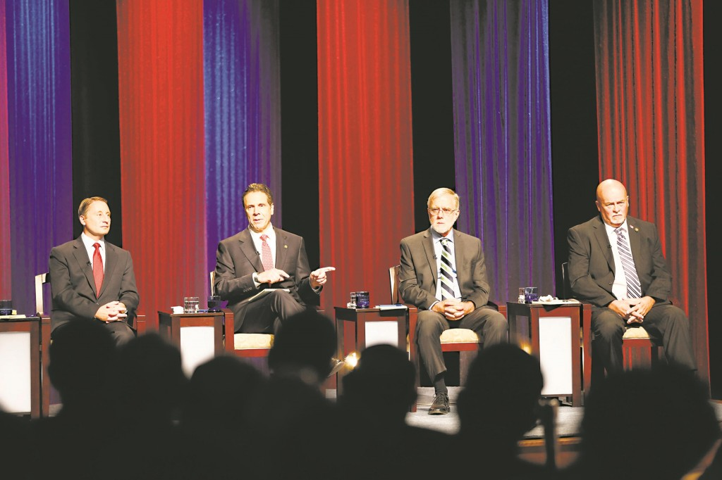 Rob Astorino (L) and Gov. Andrew Cuomo (2nd L) participate in a debate Wednesday night in Buffalo, N.Y., along with Green Party's Howie Hawkins and Libertarian candidate Michael McDermott. (AP Photo/The Buffalo News, Derek Gee)