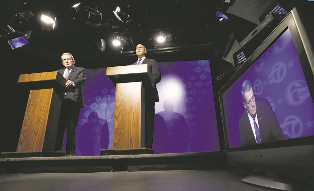 Republican Jeff Bell, left, and incumbent Democrat Cory Booker during their debate in Trenton on Friday. (AP Photo/Mel Evans)