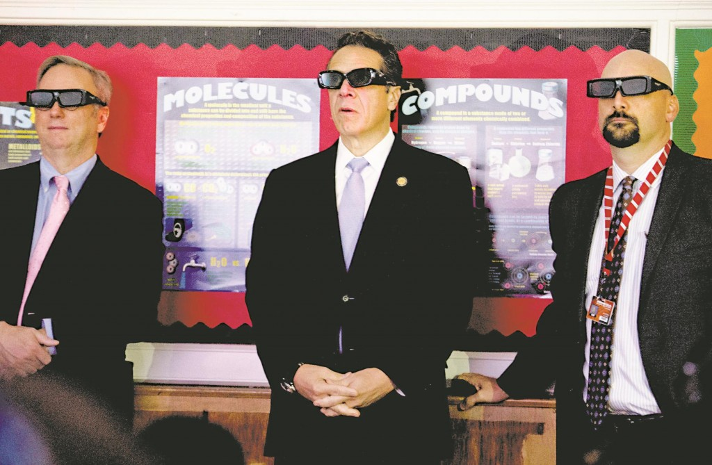 Gov. Andrew Cuomo (C) with Google Chairman Eric Schmidt in a Mineola classroom Monday, using special glasses while watching a 3-D technology demonstration to receive the Smart Schools Commission report, which calls for New York to invest $2 billion in its schools. (AP Photo/Newsday, Alejandra Villa)