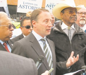 Rob Astorino (C), the Republican candidate for governor, campaigns with state Sen. Ruben Diaz in the Bronx. (AP Photo/Jim Fitzgerald)