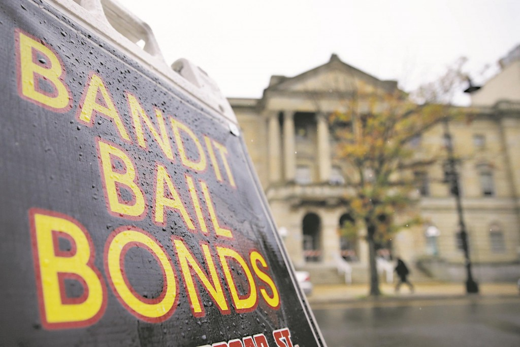 A sign is seen outside a bail bondsman across the street from Mercer County criminal courthouse in Trenton. (AP Photo/Mel Evans)
