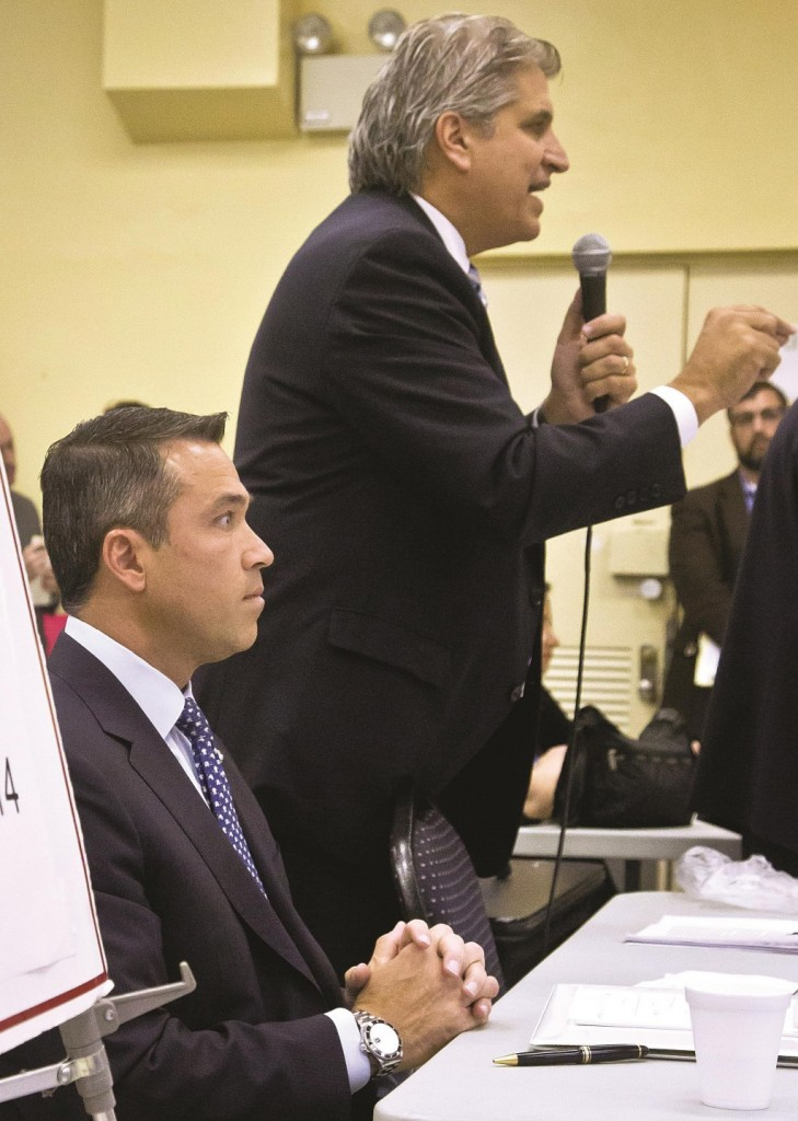 Democrat Domenic Recchia (R) on Wednesday stands next to GOP Rep. Michael Grimm at a candidates forum at the Fort Hamilton Senior Citizen Center in Brooklyn. (AP Photo/Bebeto Matthews)