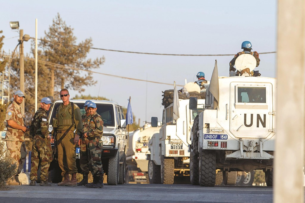 Members of the United Nations Disengagement Observer Force (UNDOF) in the Israeli Golan Heights near the Quneitra crossing between Israel and Syria. (Flash90)