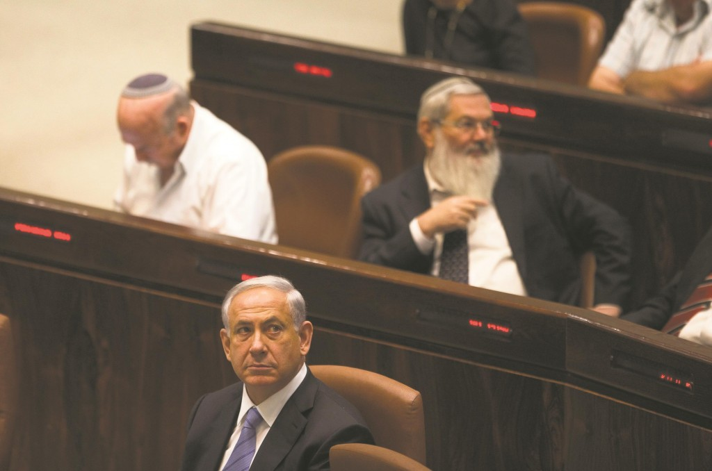 Israel's Prime Minister Binyamin Netanyahu seen at the opening of the winter session of the Knesset on Monday. (REUTERS/Ronen Zvulun)