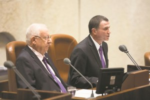 President Reuven Rivlin (L) waits as Speaker of the Knesset Yuli Edelstein speaks during the opening of the Knesset winter session on Monday. (Yonatan Sindel/Flash90)