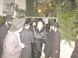 The Modzhitzer Rebbe leaving the site of the meeting.