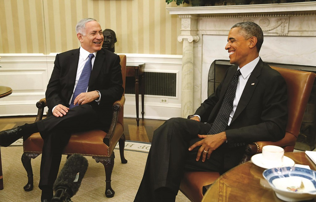 President Barack Obama (R) and Israel's Prime Minister Binyamin Netanyahu share a light moment in the Oval Office of the White House in Washington on Wednesday. (REUTERS/Kevin Lamarque)