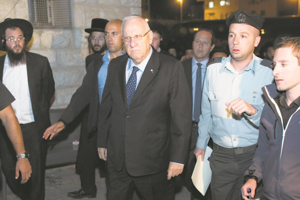 "President Reuven Rivlin arrives at the levaya of Chaya Zissel Braun, Hy""d, killed in a terror attack on Wednesday. (Yonatan Sindel/Flash90)"