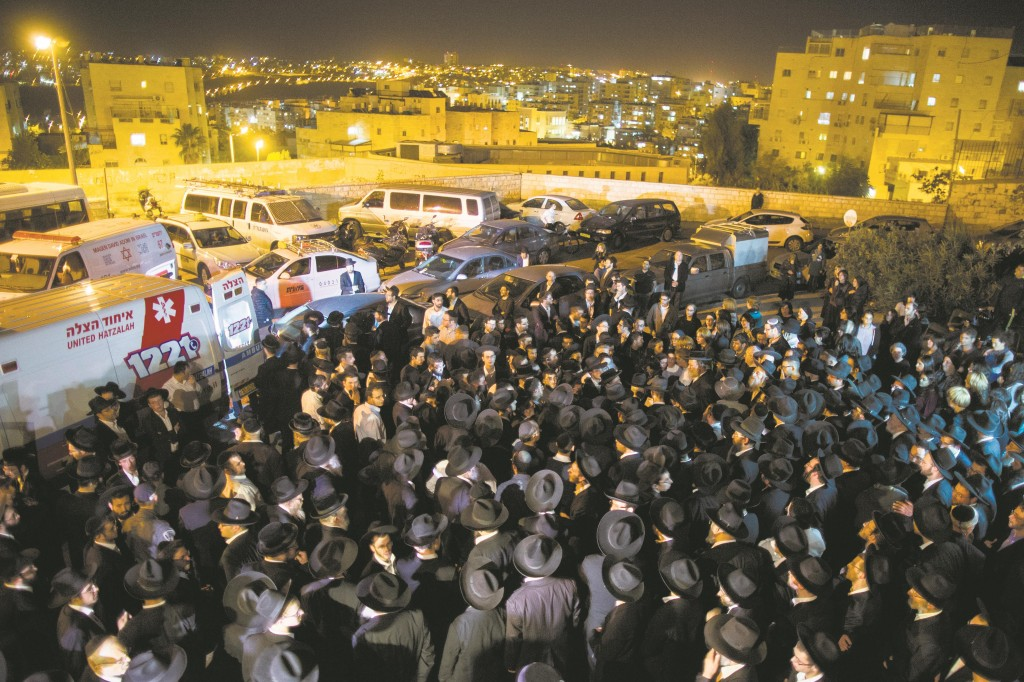"""Hundreds of friends and family attend the levayah of Chaya Zissel Braun, Hy""""d, killed in a terror attack on Wednesday. (Yonatan Sindel/Flash90)"""