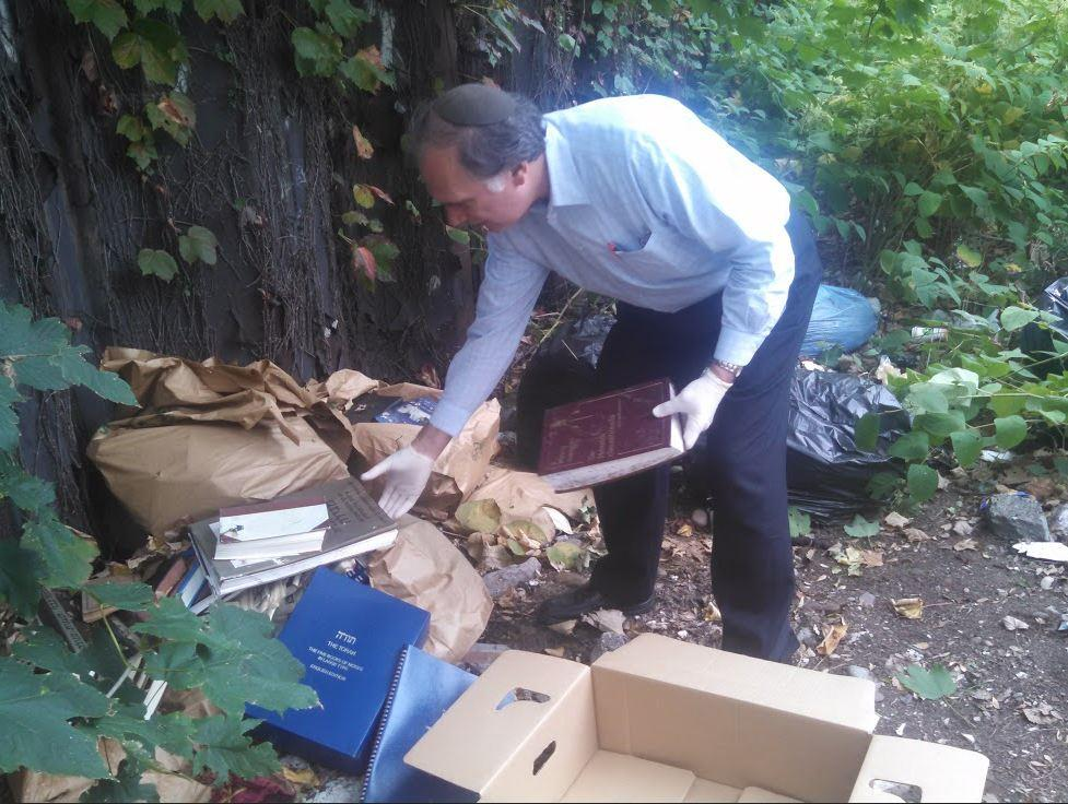 A member of Hikind's office on Monday collecting abandoned sheimos in Boro Park. (Office of Assemblyman Hikind)