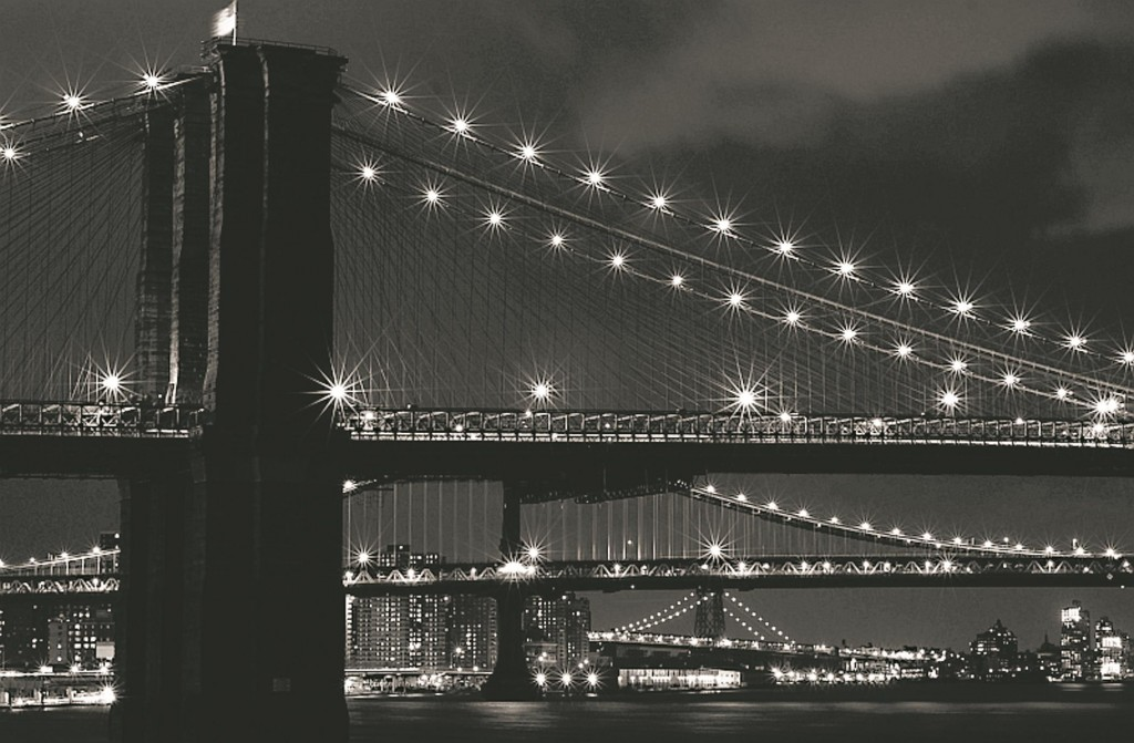 The Brooklyn, Manhattan and Williamsburg bridges late at night.