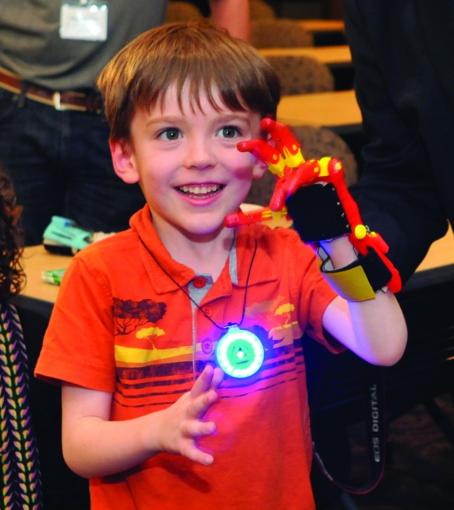 Griffin Matuszek, five and a half, tries out his new 3-D hand. (Amy Davis/Baltimore Sun/MCT)