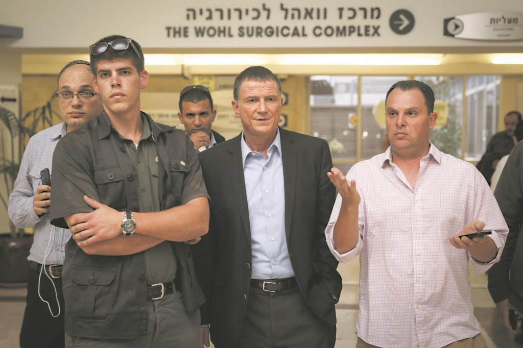 Knesset speaker Yuli Edelstein speaks with media at the emergency room of Shaare Zedek Hospital, where Yehuda Glick was hospitalized after being shot Wednesday night in Yerushalayim.  (Hadas Parush/ Flash90)