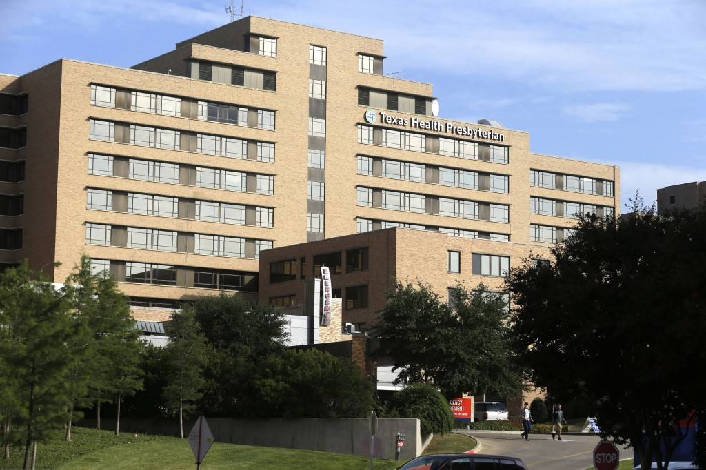 A man walks up the stairway leading to the Texas Health Presbyterian Hospital in Dallas, Tuesday, Sept. 30, 2014. A patient in the hospital is the first confirmed case in the U.S. (AP Photo/LM Otero)