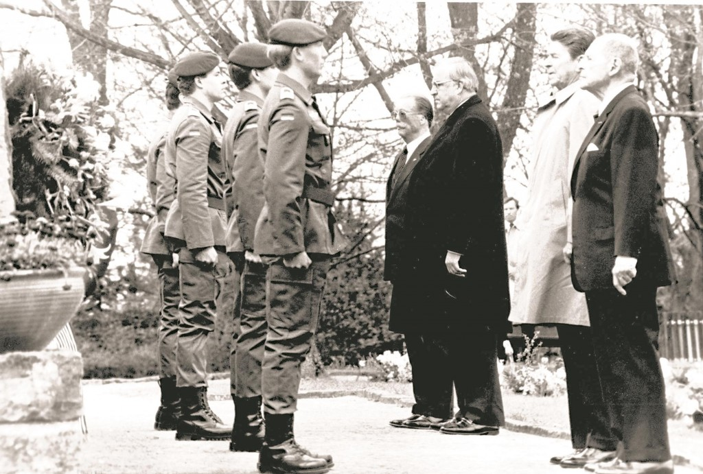President Ronald Reagan and West German Chancellor Helmut Kohl (back row) are accompanied by General Matthew B. Ridgway (right, front row) and West German General Johannes Steinhoff (left, front row) after Reagan's 1985 visit to Bitburg military cemetery. (AP-Photo/mw/stf/05/05/1985)