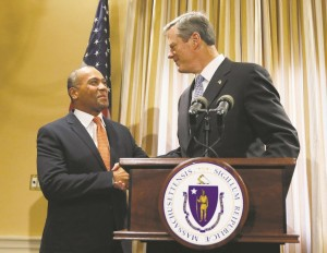 Massachusetts Gov. Deval Patrick (L) and Gov.-elect Charlie Baker shake hands during a news conference at the Statehouse in Boston, Wednesday. (AP Photo/Michael Dwyer)