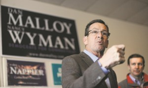 Connecticut Gov. Dannel P. Malloy speaks to volunteers at Manchester Democratic headquarters on Election Day, Tuesday, in Manchester, Conn. Malloy was facing Republican candidate Tom Foley.  (AP Photo/Jessica Hill)