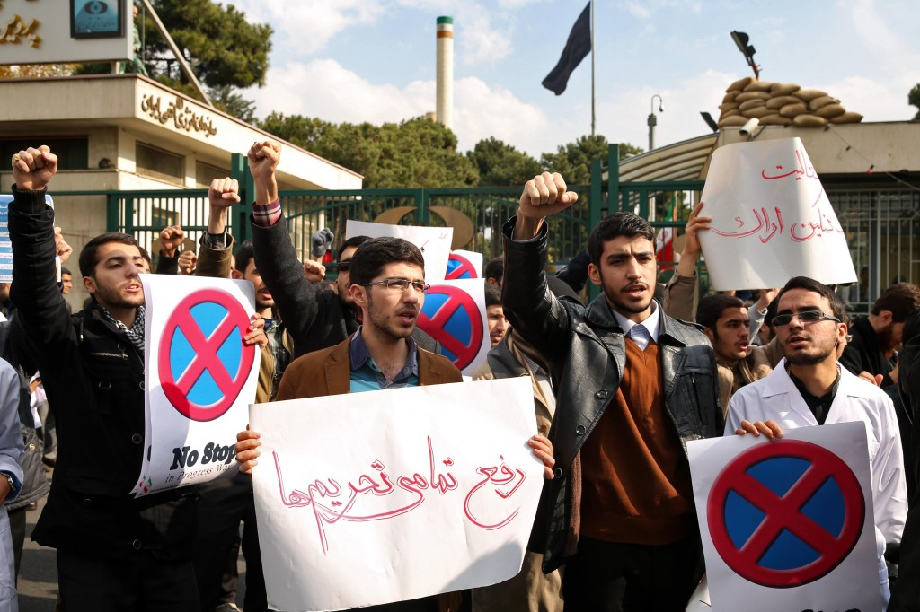 A group of Iranian students chant slogans to show their support for Iran's nuclear program in a gathering in front of the headquarters of Iran's Atomic Energy Organization in Tehran, Iran, Sunday. (AP Photo/Ebrahim Noroozi)