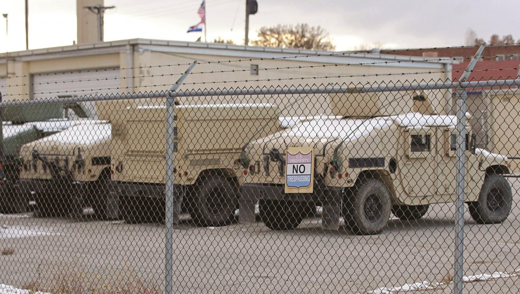 Snow-covered military vehicles parked behind Missouri National Guard depot, after a state of emergency was declared by Missouri Governor Jay Nixon, in St. Louis.  (REUTERS/Tom Gannam)