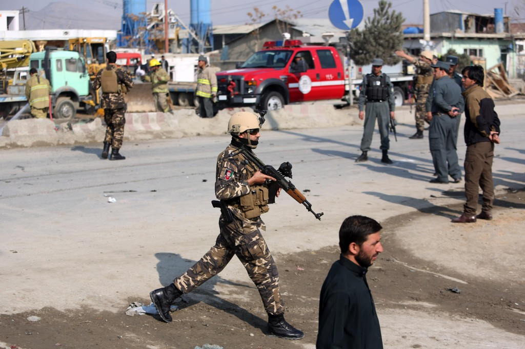 Afghan security forces inspect the site of a suicide attack in Kabul, Afghanistan, Thursday. (AP Photo/Rahmat Gul)