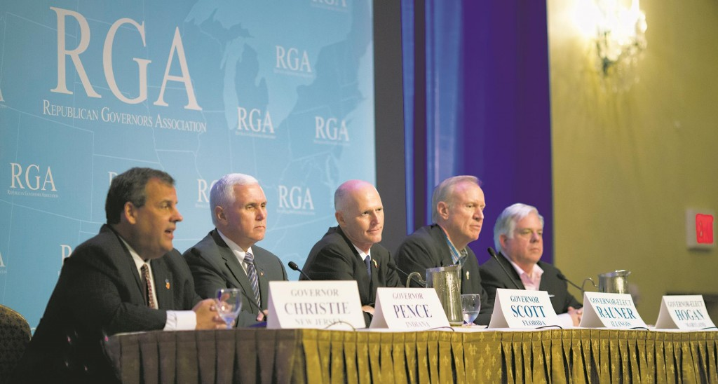 L-R: New Jersey Gov. Chris Christie, Indiana Gov. Mike Pence, Fla. Gov. Rick Scott, Illinois Gov-elect Bruce Rauner and Maryland Gov.-elect Larry Hogan talk about recent Republican party gains during a press conference at the Republican governors' conference in Boca Raton, Fla., Wednesday. (AP Photo/J Pat Carter)