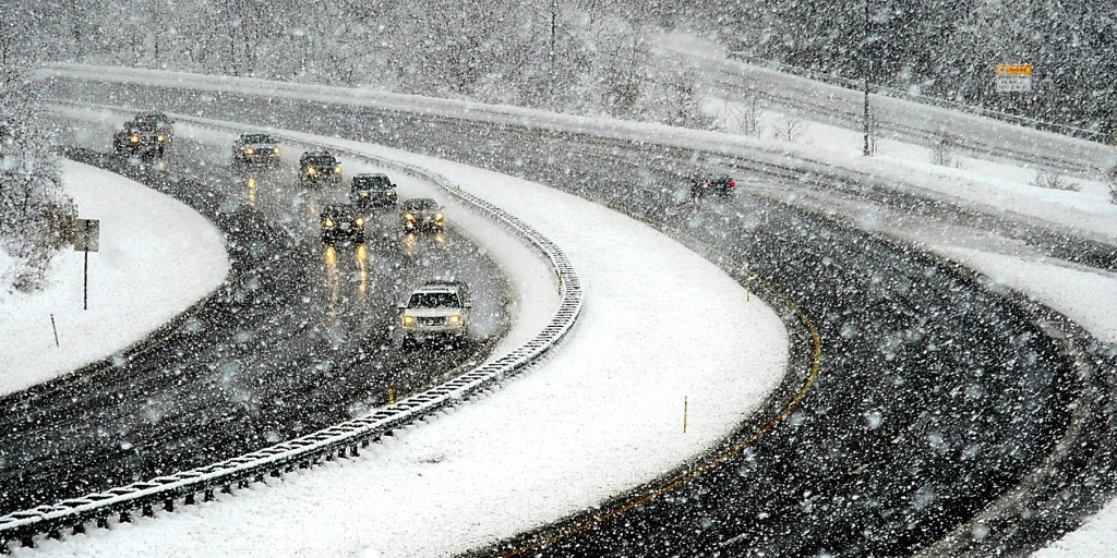 A cluster of westbound traffic (L) curves around Interstate 68 west of Hancock, Md., Wednesday. A sloppy mix of rain and snow rolled into the Northeast on Wednesday just as millions of Americans began the big Thanksgiving getaway, grounding hundreds of flights and making highways hazardous along the congested Washington-to-Boston corridor. (AP Photo/The Herald-Mail, Kevin G. Gilbert)