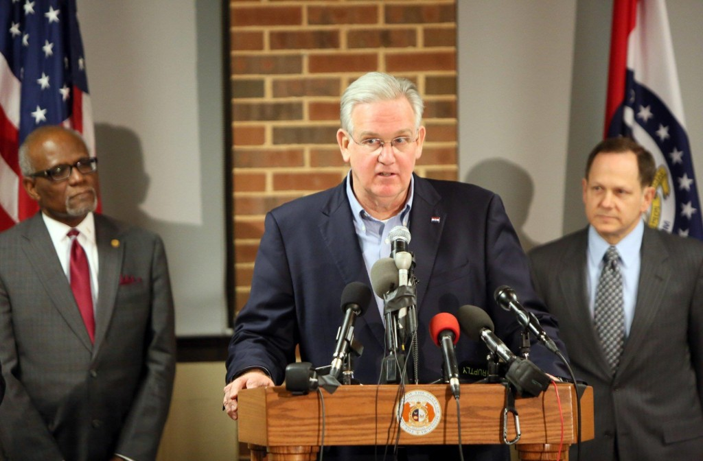 Missouri Gov. Jay Nixon (C), St. Louis County Executive Charlie Dooley and St. Louis Mayor Francis Slay call for peace as they discuss preparations in anticipation of the announcement of the grand jury decision in the Darren Wilson case, Monday. (AP Photo/The St. Louis Post-Dispatch, Huy Mach)
