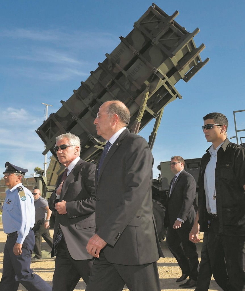 Defense Secretary Chuck Hagel and Israeli Defense Minister Moshe Yaalon walk past a Patriot missile battery as they arrive to address U.S. and Israeli soldiers after viewing Juniper Cobra 14 military exercise at Hatzor Israeli Air Force Base in Hatzor, Israel, May, 2014.  (AP Photo/Mandel Ngan, Pool)