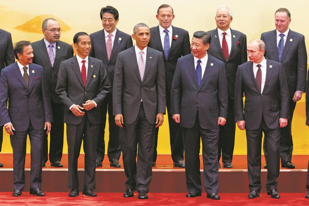 "Leaders pose for a group photo at the Asia-Pacific Economic Cooperation (APEC) summit at the International Convention Center in Yanqi Lake, Beijing, on Tuesday. Among those pictured are (L-R): Brunei's Sultan Hassanal Bolkiah; Papua New Guinea Prime Minister Peter O'Neil; Indonesia's President Joko ""Jokowi"" Widodo; Japanese Prime Minister Shinzo Abe; President Barack Obama; Australian Prime Minister Tony Abbott; Chinese President Xi Jinping; Malaysia Prime Minister Najib Razak; Russian President Vladimir Putin; New Zealand Prime Minister John Key. (AP Photo/Ng Han Guan)"