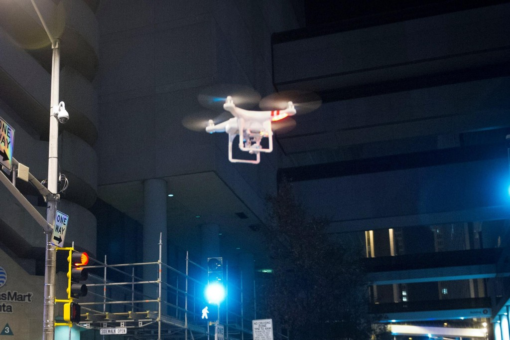 A drone hovers above an Atlanta street Tuesday, Nov. 25. (AP Photo/John Amis)