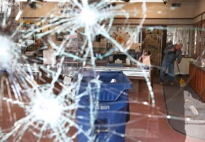 A worker cleans up glass at a business that was damaged during a demonstration on November 25. Demonstrators caused extensive damage in Ferguson and surrounding areas. (Photo by Justin Sullivan/Getty Images)