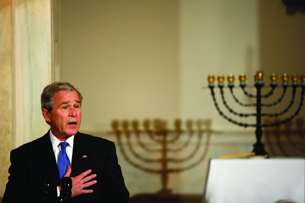 Former president George W. Bush makes remarks at a Chanukah reception in the grand foyer of the White House on December 15, 2008. (Aude Guerrucci-Pool/Getty Images)