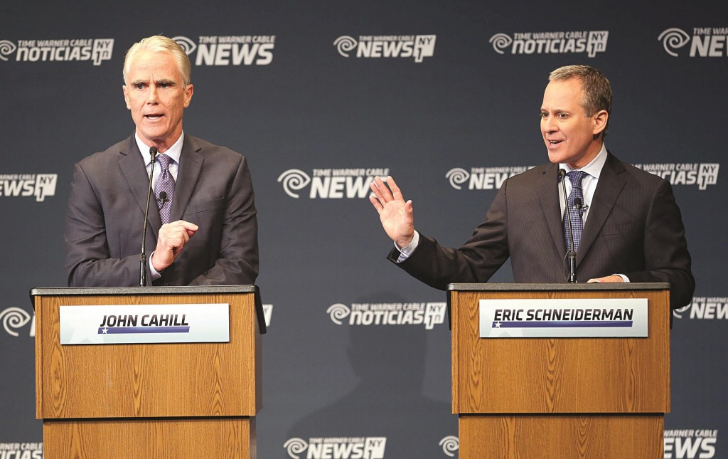 Attorney general candidates John Cahill, (L), and incumbent Eric Schneiderman on Thursday participate in a debate at Hilbert College in Hamburg, N.Y. (AP Photo/The Buffalo News, Mark Mulville)