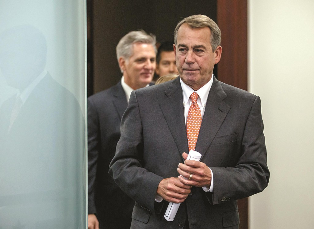 House Speaker John Boehner of Ohio, followed by House Majority Leader Kevin McCarthy of Calif., left, and others, emerge from a House GOP caucus meeting on Capitol Hill in Washington, Tuesday. (AP Photo/J. Scott Applewhite)