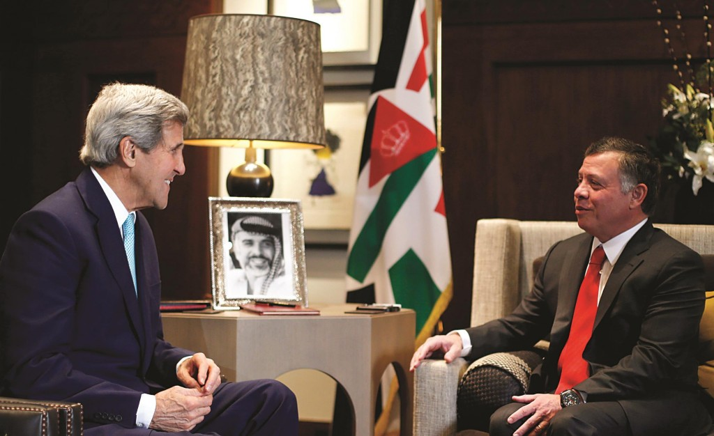 Jordan's King Abdullah (R) meets Secretary of State John Kerry at the Royal Palace in Amman on Thursday. (REUTERS/Muhammad Hamed)