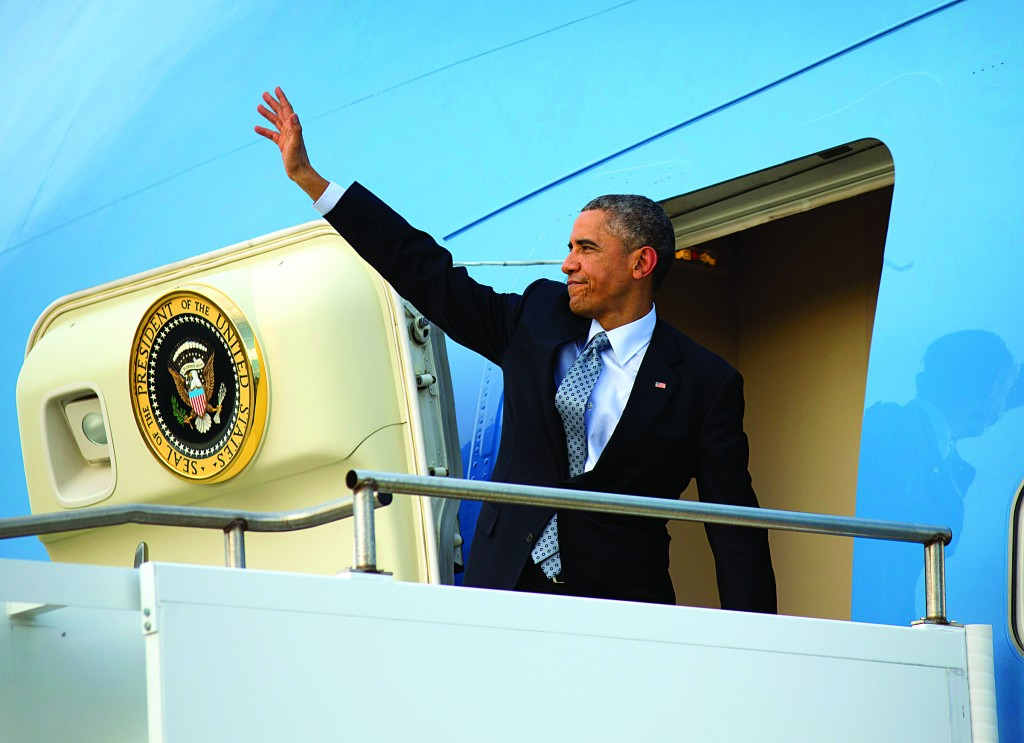 President Barack Obama readies to board Air Force One as he departs Australia, Sunday, Nov. 16, 2014. Obama is heading back to Washington after visiting China, Myanmar and attending G20 Summit in Australia. (AP Photo/Pablo Martinez Monsivais)