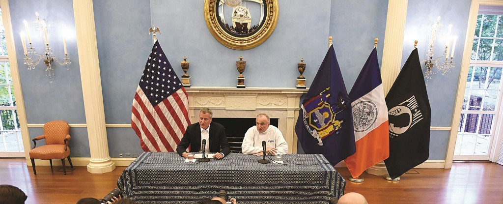 Mayor Bill de Blasio on Sunday with Commissioner William Bratton at Gracie Mansion discusses the sudden retirement of Philip Banks III (below). (NYPD-Ed Reed/Mayoral Photography Office)