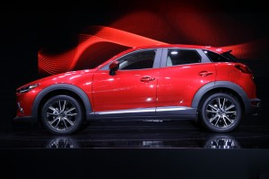 The 2016 Mazda CX-3 is unveiled at the Los Angeles Auto Show on Wednesday, Nov. 19, 2014 in Los Angeles. (AP Photo/Jae C. Hong)