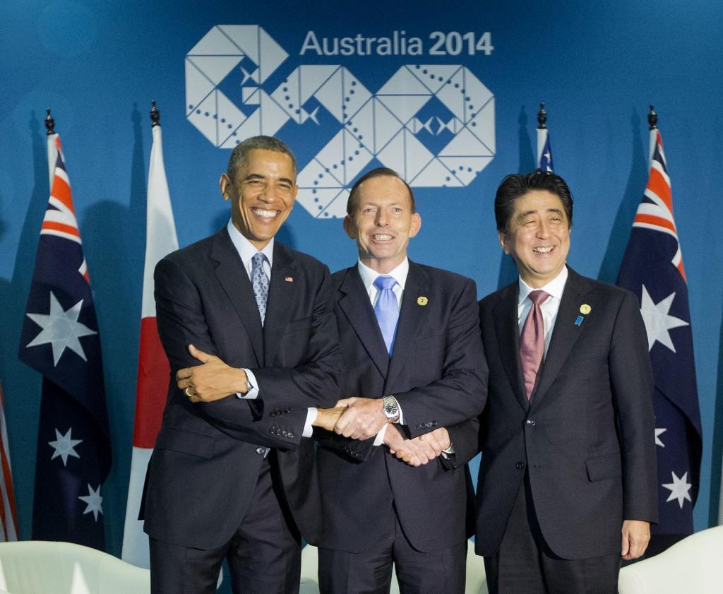 U.S. President Barack Obama, left, Australian Prime Minister Tony Abbott, center, and Japanese Prime Minister Shinzo Abe, right, shake hands at the start of their meeting at the G20 Summit in Brisbane, Australia, on Sunday, Nov. 16, 2014. (AP Photo/Pablo Martinez Monsivais)