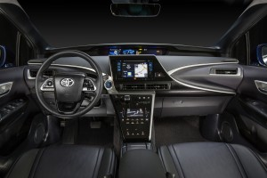 The black interior of the 2016 Toyota Mirai feels modern with a swipe screen housed in shiny piano black and offset with bright blue buttons and silver trimming. (TNS)