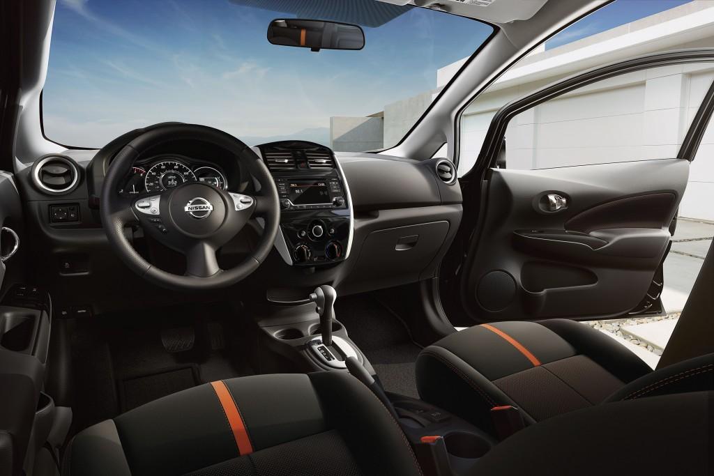 The Interior Of The 2015 Nissan Versa Note Features Suede Like Cloth Seats  With Orange