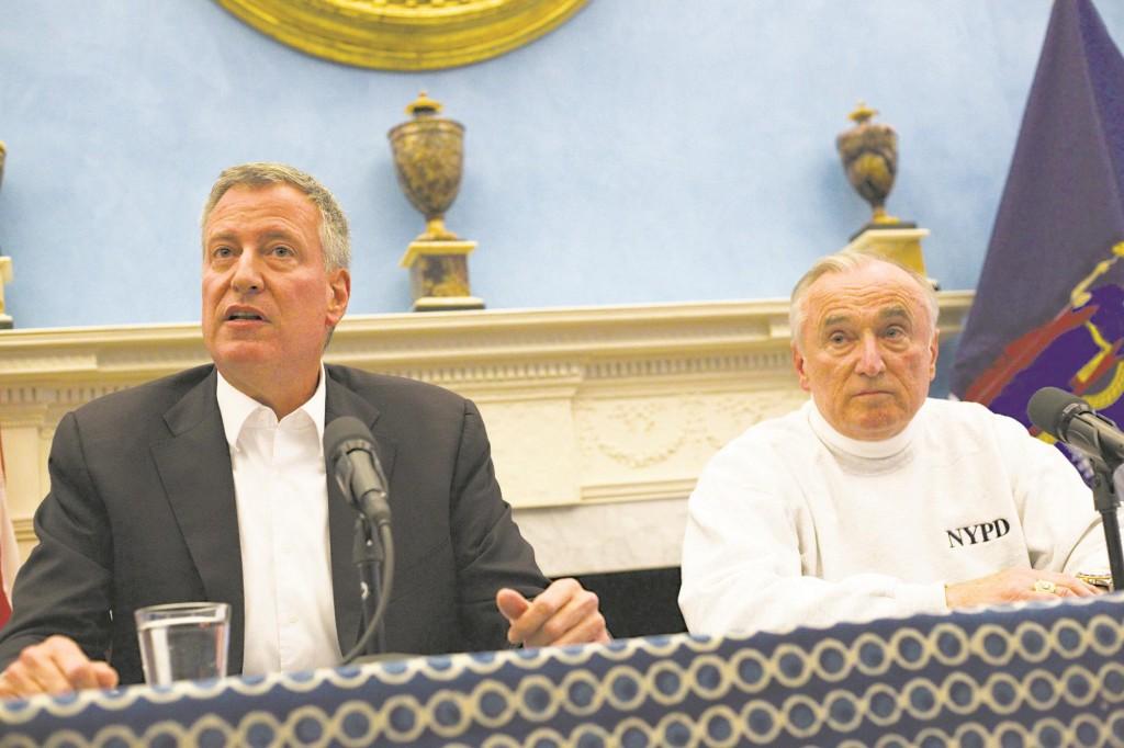 Mayor Bill de Blasio (L) and Commissioner Bill Bratton (R) spoke to the media Sunday at Gracie Mansion. (AP Photo)