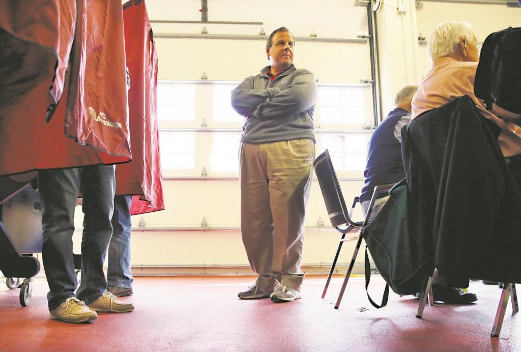 Gov. Chris Christie on Tuesday waits in line to vote in Mendham Township, N.J. (AP Photo/Mel Evans)