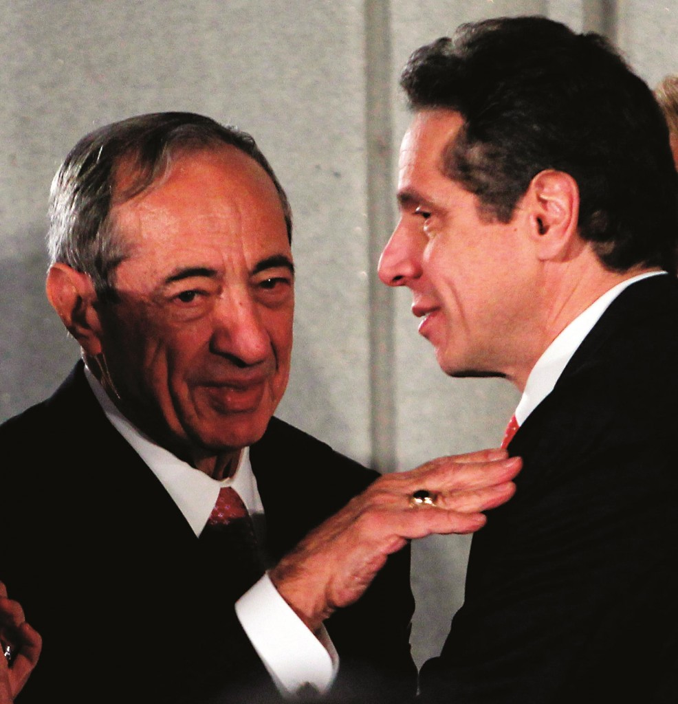 Former Gov. Mario Cuomo, (L), talks with his son and current Gov. Andrew Cuomo, during the latter's swearing-in ceremony in 2010. (AP Photo/Mike Groll)