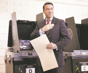 Rep. Michael Grimm smiles after voting Tuesday in Staten Island. (AP Photo/Seth Wenig)