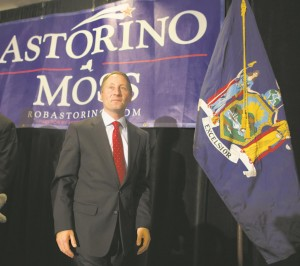 Republican Rob Astorino exits the stage Tuesday night after giving his concession speech at the Crowne Plaza Hotel in White Plains. (AP Photo/John Minchillo)